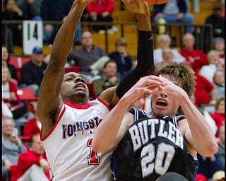 The Vindicator/Geoffrey Hauschild.YSU's DeAndre Mays (1) and Butler's Gordon Hayward (20) are unable to come up with a rebound during the second half of a game at YSU's Beeghley Center on Thursday evening.