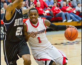 The Vindicator/Geoffrey Hauschild.YSU's DeAndre Mays (1) drives to the hoop while defended by Butler's Willie Veasley (21)  during the second half of a game at YSU's Beeghley Center on Thursday evening.