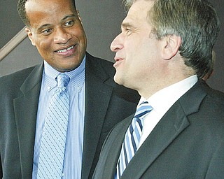 HAPPY MAYORS: While negotiations over V&M Star Steel's $650 million expansion at times were tense, Youngstown Mayor Jay Williams, left, and Girard Mayor James Melfi were all smiles Monday when the company announced the project will be built here.