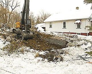 GOODBYE, BLIGHT: A vacant house at 167 Monroe St. in Campbell is no more. It was one of 11 houses that are being torn down this month with federal funds. Campbell has 137 properties in all that will be razed.