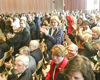 STANDING OVATION: Nearly 500 people in the Chestnut Room at YSU's Kilcawley Center rose in a standing ovation as trustees announced the selection.