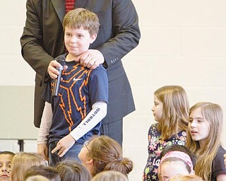 INQUIRY: C.H. Campbell Principal Kent Polen allows student Jack Villano to ask Jack Young, of Rotary International's Shelter Box board of directors, a question during a Wednesday assembly at the Canfield school.