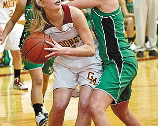 TOURNAMENT PREVIEW: Mooney's Taylor Woytek (34) eyes the basket after making a rebound while defended by West Branch's Andrea Wingett (40) during Wednesday's game at Mooney. The Cardinals won, 33-31, and will play the Warriors again on Feb. 24 in the tournament.