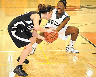 Ursuline's Briana Curd applies the full court press against Girard's Caroline Standohar during Ursuline's 60 - 29 win at Mineral Ridge on Monday night.