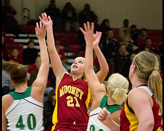 The Vindicator/Geoffrey Hauschild.Mooney's Kelly Martino (21) successfully shoots for two past West Branch's Andrea Wingett (40) and Michele Sosnick (30) during the third quarter of a game at Autintown Fitch High School on Wednesday evening..