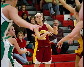 The Vindicator/Geoffrey Hauschild.Mooney's Dominique Zordich (22) makes a pass during the third quarter of a game at Autintown Fitch High School on Wednesday evening..