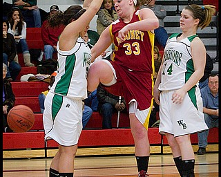 The Vindicator/Geoffrey Hauschild.Mooney's Christine Pelini (33) looses her hold on the ball after colliding with West Branch's Katie Sellaroli (33) and Tia King(14) during the fourth quarter of a game at Autintown Fitch High School on Wednesday evening..