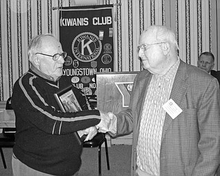 Special to the Vindicator END OF ERA: Celebrated during the Feb. 19 luncheon meeting of the Kiwanis Club of Youngstown was the discovery of the time capsule buried in 1921 at The Rayen School and the end of the football rivalry that once existed between South High School Warriors and the Rayen Tigers. To emphasize the importance of the events, Chuck Whitman, a Kiwanian and president of South High School Alumni Association, at left, presented a framed copy of The Vindicator article on the time capsule to Charles Rudibaugh, a Kiwanian and president of the Rayen trustees. Those present agreed to continue to support Youngstown City Schools with scholarships and financial aid.