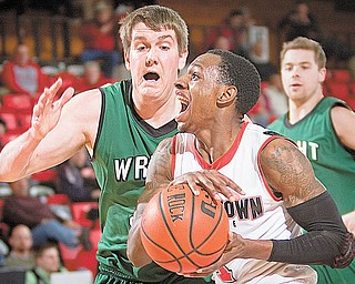 DRIVING POINTS: YSU's DeAndre Mays (1), under pressure from Wright State's Ronnie Thomas (40), drives for a layup during the second half of Thursday's game at YSU's Beeghly Center. The Raiders edged the Penguins, 76-73.