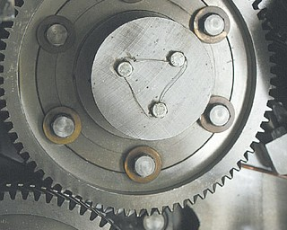 A detailed view of one of the many huge gears that moves the press.