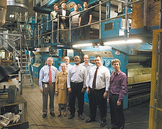 The Vindicator's modern offset printing press will produce a brighter, bolder, more colorful newspaper in a new contemporary size. Standing in front of The Vindicator Printing Company's