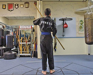 PRACTICING: Ben Powell, 13, pictured, has been a karate student at A.E. Vea Karate for five years. Powell, who has cerebral palsy, said the physical activity helps lessen tightness in his legs caused by the condition.