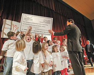 "SUCCESS STORY: Kindergarten students at South Range Elementary School ham it up with U.S. Rep. Tim Ryan as they help him hold up a mock $100,000 check. Ryan presented the check to the United Way of Youngstown and the Mahoning Valley to expand its ""Success by 6"" program. The ceremony was Monday at the North Lima school, one of two Mahoning County schools to house the Success by 6 pilot program."