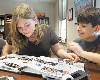 Poland North Elementary fourth graders Paige Kellgren and Julian Diaz, both 10, look over their recycling-themed scrapbook. The scrapbook is part of the school's submission to the Disney's Planet Challenge contest.