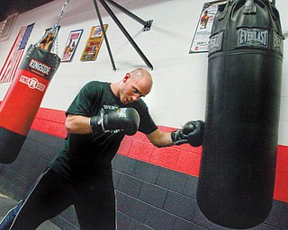 Kelly Pavlik works out at the South Side Boxing gym. Pavlik is starting preparations to fight Sergio Martinez on April 17.
