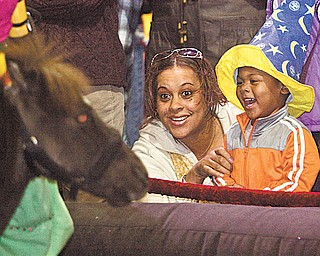 """Dominique Moore and 3-year-old Stevie Dean are equally excited by a pony at the Covelli Centre. The animal was part of the entertainment before the circus. Bros. and Barnum & Bailey's """"Zing Zang Zoom"""" Circus at the Covelli Centre on Thursday night. The circus continues there through Sunday night."""