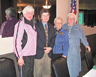 The functions and services provided by the Trumbull County Lifelines to make community life healthier were explained by John Myers, director of the organization, second from the left, when he spoke at the January meeting of Warren Republican Women's Club. Joining the speaker at the event at DiLucia's Banquet Room were, from left, Paula Snyder, secretary; Carol Griffiths, president; and Cary Ann Koren, second vice president of the club.