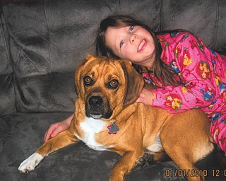 Carli Osiniak, 5 1/2, daughter of Ron ad Lisa Osiniak of Campbell, is relaxing with her best friend, Brutus.