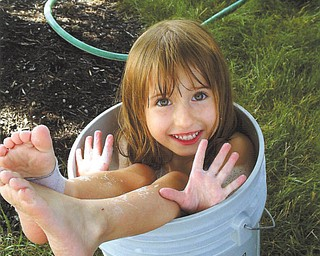Riley Sweder, daughter of Michael Sweder of Columbus, was caught in somewhat of a predicament when her grandma, Mary Ann Sweder of Struthers, took this picture.