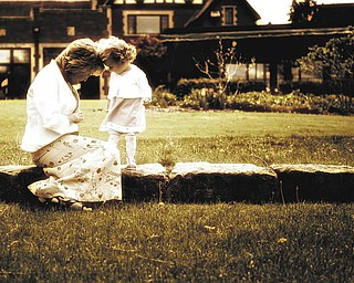 Laurie and Hannah LaPlante share a moment together while preparing for a MotherÕs Day family portrait. Taken by John LaPlante, husband and dad..