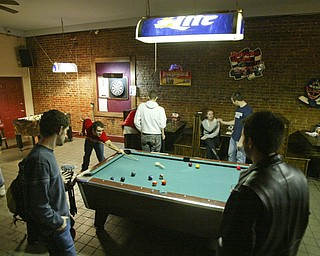 Downtown Draught House is popular place to meet and play pool.