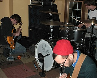 Braille bassist Josh Good, 28, of Boardman, far left, and guitarist Anthony Cucitrone, 22, of Boardman, manipulate their music with effects pedals, while drummer Ian James, 23, of Boardman, keeps the beat.