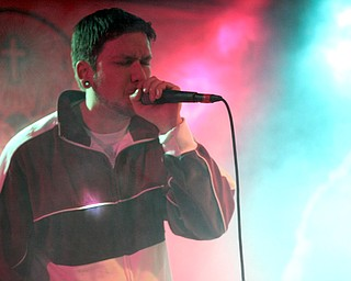 Nick Miller, 31, of Youngstown, a member of the band Foursquare Junkies, performs Friday, Feb. 26, 2010, at Barley's.