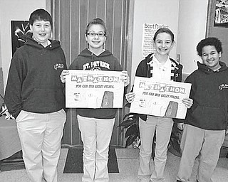 SPECIAL TO THE VINDICATOR  During the past 25 years St. Patrick School in Hubbard has raised $40,000 for St. Jude's Children's Hospital by conducting an annual Math-athon. This year students at the school participated in the event and raised $1,076 for the hospital by soliciting pledges from their sponsors and completing the workbooks. Proudly displaying the official math-athon workbooks are, from left, Jack Sebest, Daelyn Lazor, Concetta Seidler and Alex Graham, students in Mrs. Hanni's 6th grade class at the school.