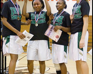 Geoffrey Hauschild|The Vindicator.Ursuline's Dominique Jenkins (15), Keneesha Tensley (11), Jasmine Brown (20), and Allison Naples (31) celebrate and pose for photographs following the game at Mineral Ridge High School on Saturday afternoon. After winning, the team wore shirts in support of Uruline's boys basketball player Jordan Dubose (45) who was recently diagnosed with a serious illness.