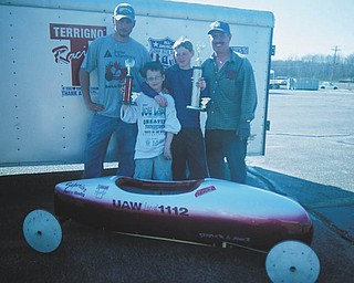 All smiles after a hard day of Soap Box Derby racing in Mineral Ridge are: David Deiley, pit pal for his son, Dominic J.DuMaire, both from Girard, and Joseph M. Puntel with his father and pit pal, Joe Puntel Sr., both of Austintown. All were winners..
