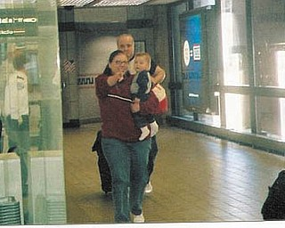 Tom and Andrea McGoogan arrive at Pittsburgh Airport in 2006 from Moscow, Russia, with their son, Nicholas Max. Nicholas sees his new family for the first time..