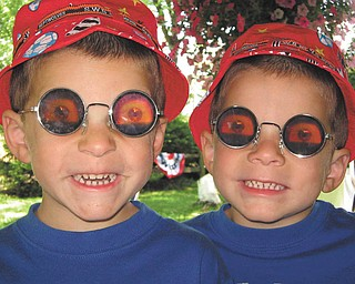 Twins Joshua and Jordan Maggie are goofing around outside in the springtime. Sent by MacKenzie Maggie of New Castle Pa..