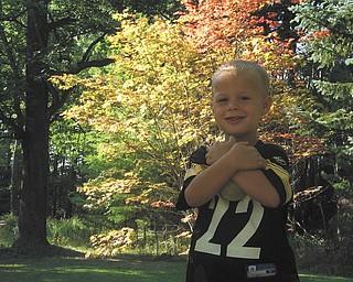 Ryan Joseph Maggie Jr. is posing buy a beautiful Japaneese maple tree in his backyard. Sent by MacKenzie Maggie of New Castle, Pa..