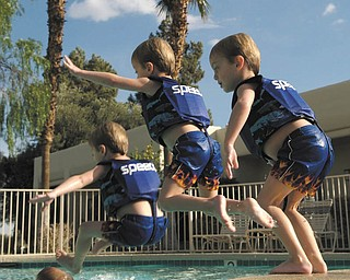 Here is a picture of 4-year-old Nicholas LaPlante jumping into a pool while.visiting his grandparents in Palm Springs, . Calif., a few years ago. His dad, John, took quick, progressive shots as he jumped in and then put them all together for an interesting shot. Makes you look twice!
