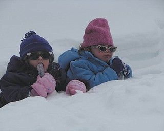 Mia and Carlie Lazazzera taking a break from the snow and enjoying an icicles..