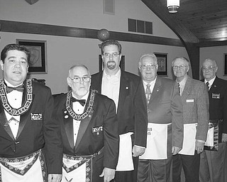 SPECIAL TO THE VINDICATOR Longtime lodge members honored Argus Masonic Lodge 545 of Canfield paused during its Feb. 12 meeting at the lodge to pay tribute to 18 longtime members. Recognized during the event for their years of service were: William K. Dressel of Florida and Willard H. Hughes of Canfield, 65 years; Samuel C. Boak of Canfield, M. Dudley Buck of Youngstown and Harold W. Kaser of Delaware, Ohio, 60; William L. Ewald of Ashland, Va., David R. Gibson of Columbiana, Harold J. Grove of Everett, Pa., and Gary L. Smith of Canfield, 50; Jon R. Anstrom, Henry J. Domkowski, Robert J. Jones and Gale W. Reedy, all of Youngstown, Michael D. Boda, Walter A. Coy and David A. Jenkins, all of Canfield, Charles H. Day of Mineral Ridge and Terrance J. Reese of North Lima, all 25. Each honoree received a gold pin, and the 25-year awards were presented by Donald Huntley, who was master of the lodge in 1985. Martin R. Schuller was among the guests. Denny Furman was master of ceremonies. Among those participating in the event were, from left, R. Christopher Gillam, master of the lodge; Huntley, Jones, Reedy, Reese and Schuller.