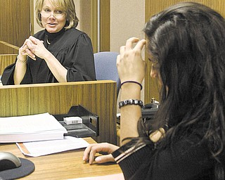 Judge Theresa Dellick of Mahoning County Juvenile Court presides over a teen court session with Grimilda Ocasio-Santiago serving as a student bailiff.