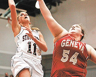 Struthers' Katelyn Ardale (11) stays out of the reach of Geneva's Natalie Stanley (54) during first-quarter action in their District II regional semifinal Tuesday at Barberton High School. The Wildcats defeated the Vikings, 50-46.