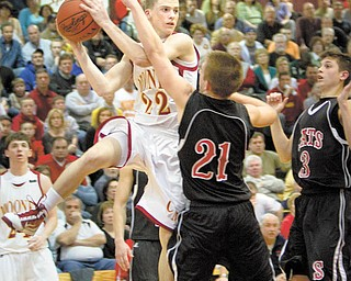 Mooney's Danny Reese (22) negotiates a pass over the heads of Struthers' Nick Ragan (21) and Jake Jakubec (3) during the third quarter of a game at Boardman High School on Wednesday afternoon.