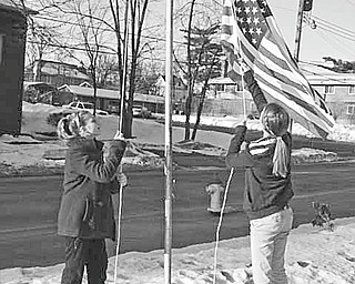 The Vindicator   The sixth-grade class at St. Patrick School in Hubbard has been given the privilege of continuing the tradition of raising the American flag each school day morning.  Showing their patriotism by raising the flag March 4 are, from left, Michaela Huber and Concetta Seidler. When classes come to a close in the afternoon, they lower the flag, carefully fold it and put it away for the next day.