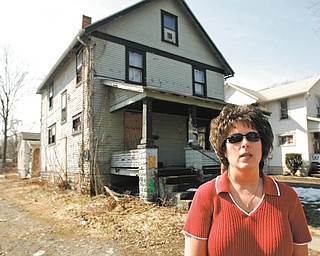 Lori Graham, Warren's Neighborhood Stabilization Program coordinator, said  housing demolitions have continued through the winter, but the pace will pick up as the weather improves. The house behind her soon will experience the wrecking ball.