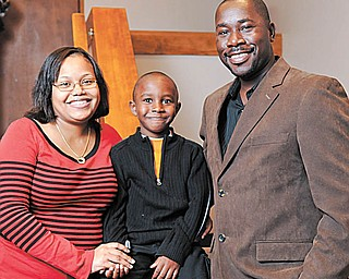 The Clervil family from Florida includes, from left, Jennie; Brian, 5; and Lesly Clervil. They visited the congregation of St. Michael Church in Canfield Sunday to tell their personal experiences with the Haiti earthquake.
