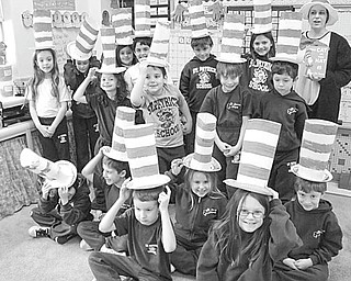 """The Vindicator  The birthday of Dr. Seuss, who was born in 1904 in Springfield, Mass., was celebrated on March 3 by the children in Mellony Leonard's second grade class at St. Patrick School in Hubbard. Taking a cue from one of the author's best-loved books, the young pupils wore the """"Cat in the Hat"""" hats they made for the occasion. They also participated in a variety of activities and listened as the story of """"The Cat in the Hat"""" was read by their teacher."""