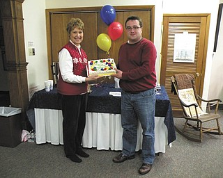 THE VINDICATOR  Salem Preservation Society met on Feb. 4 at Salem Historical Society to celebrate the founding of the organization. To mark the occasion, the birthday cake displayed by, from left, Karen Carter, vice president, and Craig Brown, president, was shared by members during the social hour. The guest speaker was George W.S. Hayes, who spoke on the Salem Sustainable Comprehensive Plan. The club is continuing the sale of Carriage House Books for $22. For more information contact Brown at (330) 332-0388.