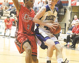 BBALL - Alex Doneyko drives to the hoop as (3) Devonta Brooks plays defense Tuesday night in Canton. - Special to The Vindicator/Nick Mays