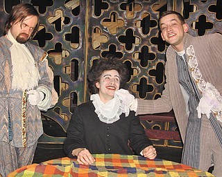 """The cast of Kent Trumbull Theater's production of """"Tartuffe"""" gathers in a scene."""