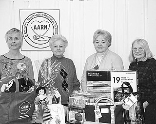 """The Vindicator Alzheimer Network fundraiser A charity auction, """"Valley Memories,"""" will be presented by volunteers of the Alzheimer Network Saturday at the Fifth Season Banquet Center, 1400 N. Canfield-Niles Road, Mineral Ridge. Doors will open at 6 p.m., and there will be Chinese, silent and live auctions for items donated by area individuals and businesses, including those displayed by, from left, Mary Kay Kollat, Dorothy Leone, Mary Ann Frank and Dorothy Barto. Entertainment will be by Take II. For tickets, call the Alzheimer's Assistance and Referral Network at (330) 788-9755. Proceeds will fund the Network's special caregiver education series, research support program, family groups, info-line and public awareness events."""