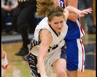 The Vindicator/Geoffrey Hauschild.Lowellville's Emily Carlson (14) takes a tumble on her way to the basket ahead of Western Reserve's Tori Korda (33) during the fourth quarter of a game at Lowellville High School on Monday evening.