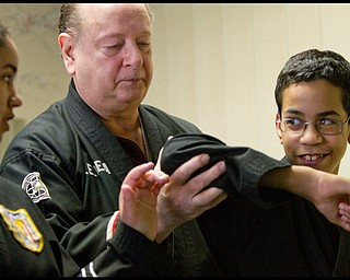 The Vindicator/Geoffrey Hauschild.?Todd? Vea (center) gives instruction to Ben Powell (13) (right) and his sister, Heather Powell (17), during a lesson at AE Vea Karate along Belmont on Friday afternoon.