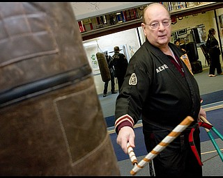 The Vindicator/Geoffrey Hauschild.?Todd? Vea strikes a bag with a __ during a karate lesson at AE Vea Karate along Belmont Ave. on Friday afternoon..
